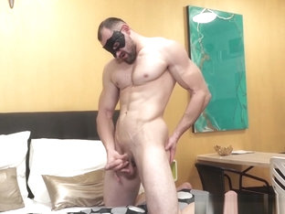 Muscular stud wears a mask for sensual solo performance