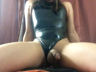Femboy in a shiny rubber swimsuit rides dildo