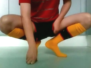 Stroking in Arsenal soccer outfit