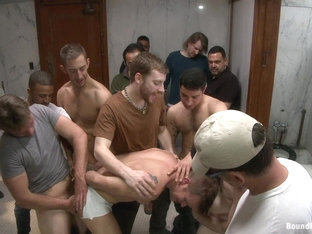 Bound in Public. Straight stud gets gang fucked in a crowded cruising bathroom