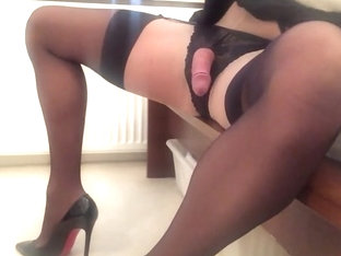 Black stockings showing cock.