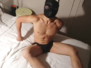 Horny stud got himself a cute puppy mask - punches his hard muscles & cums
