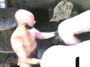 Muscular hunk pummells two buttholes
