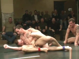 Ripped duo dominating wrestling match