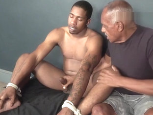 bound black guy serviced by older black man