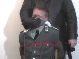 chairtied army officer gagged