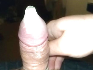 Close up slow motion condom cum