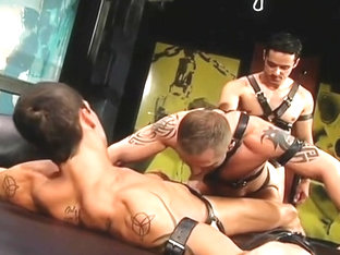 Rafael Alencar in a leather threesome