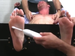 Bound hunk businessman has feet and cock tickle treated