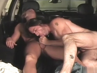 two long hair guy play in car