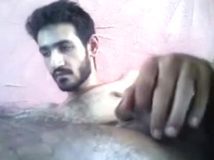 Attractive boy is frigging in the bedroom and filming himself on camera