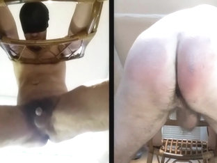 Guy's ass whipped hard by machine with plastic paddle