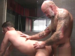 Bearded daddy drills and cums sprays a good looking gay jock