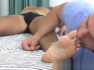 Amazing muscular hunk gets a footjob after sucking some toes