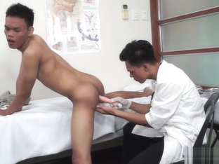 Asian doctor gives his patient head