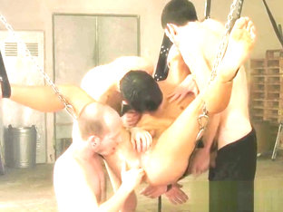 Submissive twink hangs while being fisted and pounded