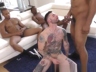 Inked whitey takes bbcs for cum in mouth