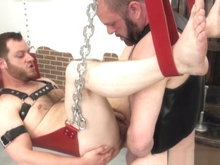 Stud fucked in swing bareback by leather bear