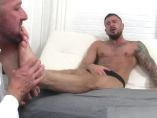 Tattooed guy gets feet licked