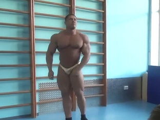 Beefy Bodybuilder in Skimpy Gold Posers