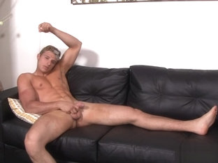 Military muscled adonis jerks his cock