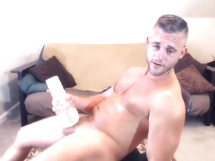 Blonde adonis jacks his cock with a fleshlight