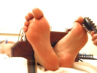 tickle toy feet on the table tickling