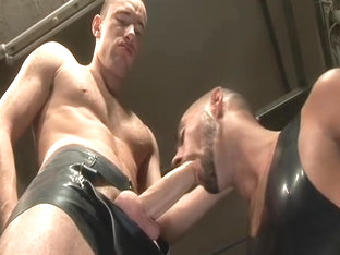 Rubber skin gets fucked by big dicked leather hottie
