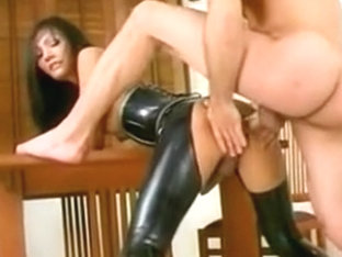 Hot shemale in a latex outfit rides a horny guy's cock