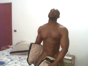 African hunk playing with pillows and himself
